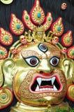A escultura da face do deus em Nepal fotografia de stock royalty free