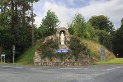 Escultura das Aves Maria nas estradas transversaas Fotografia de Stock