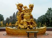 Escultura de oro de Budai Imagenes de archivo
