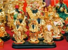Escultura de oro de tres dioses chinos Fu Lu Shou Vino del Rin Lok Siew Fotos de archivo libres de regalías