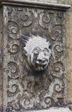 Escultura de pedra da cara na cidade velha em Solothurn fotos de stock royalty free