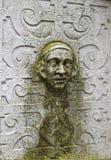 Escultura de pedra da parede da cara na cidade velha em Solothurn imagens de stock royalty free