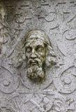 Escultura de pedra da parede da cara na cidade velha em Solothurn fotos de stock