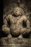 Escultura de pedra de um Yaksha em cavernas de Ajanta imagem de stock royalty free
