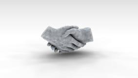 Escultura del apretón de manos foto de archivo