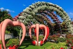 Escultura del paisaje en las flores del parque Fotos de archivo