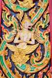 escultura dourada do ângulo no templo público tailandês Fotos de Stock Royalty Free