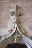 Escultura en el Lonja de la seda, edificios históricos en valle Imagenes de archivo