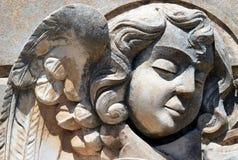 Escultura funeraria de la cara del niño hermoso del ángel de Avola, Sicilia Imagenes de archivo
