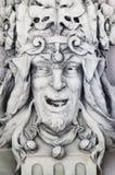 Escultura na forma da cabeça de um jester Imagem de Stock Royalty Free
