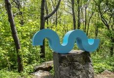 Escultura nas madeiras Fotos de Stock Royalty Free