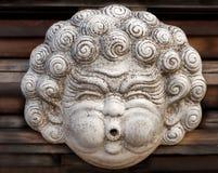 Escultura principal con las mejillas rechonchas Foto de archivo libre de regalías