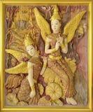 Escultura tailandesa de la tradición en la pared del templo. Fotografía de archivo libre de regalías