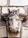 Escultura velha da cabeça de cavalo Fotos de Stock Royalty Free
