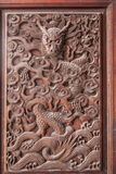 Esculturas excelentes de Fushun, Sichuan no condado de Fushun das portas de grande salão do templo Fotografia de Stock Royalty Free