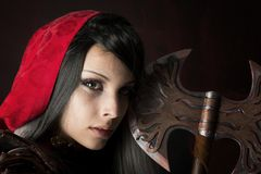 Escuro - capa de equitação vermelha fotografia de stock