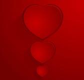 Escuro - cartão vermelho com três corações Foto de Stock