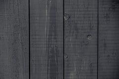 Escuro - cerca rústica pintada cinzenta Textura cinzenta escura das placas de madeira Obscuridade do vintage - cinzento pintado r imagem de stock