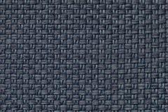 Escuro - fundo azul de matéria têxtil com teste padrão quadriculado, close up Estrutura do macro da tela Imagens de Stock
