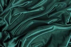 Escuro - fundo de seda da tela de pano de veludo do cetim verde Fotografia de Stock