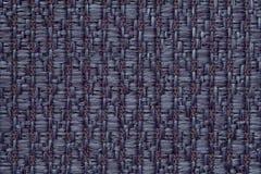 Escuro - o azul fez malha o fundo de lã com um teste padrão do pano macio, felpudo Textura do close up de matéria têxtil Fotos de Stock Royalty Free