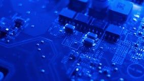 Escuro - placa de circuito eletrônico azul video estoque