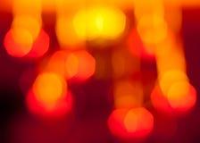 Escuro - teste padrão vermelho e amarelo do bokeh Imagem de Stock Royalty Free