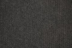Escuro - textura cinzenta da malha de lãs foto de stock