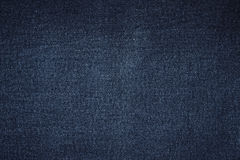 Escuro - textura de calças de ganga Foto de Stock Royalty Free