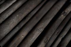 Escuro - textura de madeira cinzenta do carvão vegetal, fim acima. Imagem de Stock Royalty Free