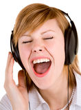Escuta a música com auscultadores Imagens de Stock