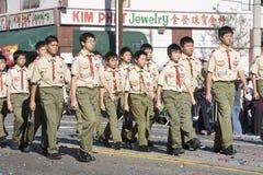 Escuteiros chineses do menino da parada do ano novo Imagem de Stock