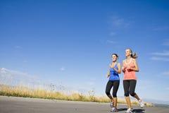 żeńscy horyzontalni joggers Zdjęcia Royalty Free