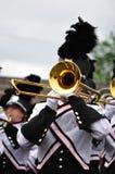 Esecutore della fanfara che gioca Trombone nella parata Immagine Stock