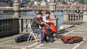 Esecutori del violoncello Fotografie Stock