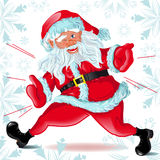 Esecuzioni e strizzatine d'occhio del Babbo Natale Fotografia Stock