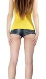 Eselsfrauentragen kurze kurze Jeanshose mit gelbem Trägershirt Stockbild