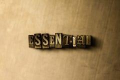 ESENCIAL - el primer del vintage sucio compuso tipo de palabra en el contexto del metal Imagen de archivo libre de regalías