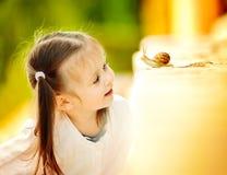 Eseniya和蜗牛 库存照片