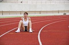 Esercitazione asiatica della ragazza di sport. Immagine Stock