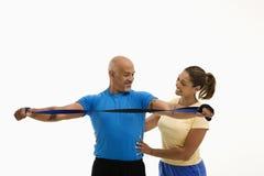 Esercitazione dell'uomo e della donna. Immagini Stock