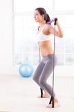 Esercitazione della donna. Immagine Stock