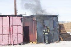 Esercitazione della stazione di addestramento del fuoco del vigile del fuoco Fotografia Stock Libera da Diritti