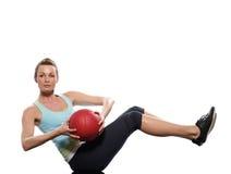 Esercitazione di posizione di Worrkout della sfera di forma fisica della donna Immagini Stock