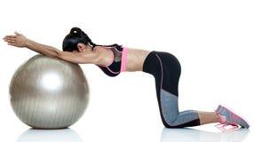 Esercizi di forma fisica della donna isolati Fotografia Stock