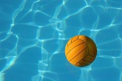 Esfera amarela de Waterpolo na associação azul Fotografia de Stock