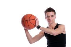Esfera causal do basquetebol da terra arrendada do homem Fotos de Stock Royalty Free