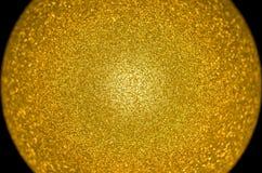 Esfera coloreada oro centrada Imagen de archivo libre de regalías