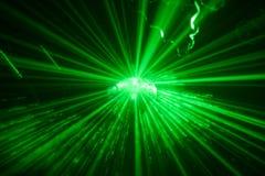 Esfera de brilho verde do disco no movimento fotografia de stock royalty free