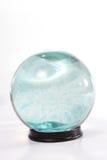 Esfera de cristal com a roda azul imagens de stock